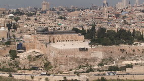 Jerusalem old city aerial perspective as traffic passes below stock video footage