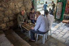 Jerusalem Old City. JERUSALEM - APRIL 18, 2014: Typical street scene of backgammon players, in the old city of Jerusalem, Israel Royalty Free Stock Photo