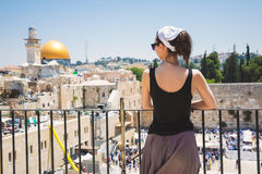 Jerusalem old city. Girl looks at the Wailing Wall in Jerusalem stock images