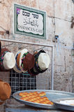 Jerusalem, Old City, Israel, Middle East. Hats for sale and the sign of Damascus Gate on September 6, 2015. The Damascus Gate is one of the main entrances to the royalty free stock images