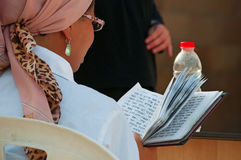 Jerusalem, Old City, Israel, Middle East. An Orthodox woman reading the Torah in the Old City on September 6, 2015. Orthodox Jews are those who strictly follow stock photo