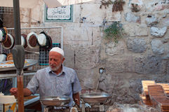 Jerusalem, Old City, Israel, Middle East. A seller of sweets at Damascus Gate on September 6, 2015. The Damascus Gate is one of the main entrances to the Old stock images