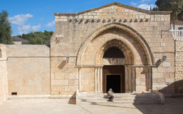Jerusalem - The orthodox church Tomb of the Virgin Mary under the Mount of Olives and the beggar. Stock Photography