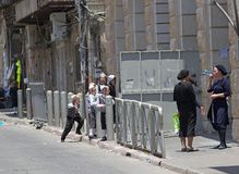 Jerusalem. People, women and children, in traditional dress are in the street at Mea She'Arim, the jewish orthodox district in Jerusaelm, Israel. Mea Shearim is Stock Photos