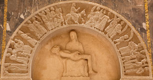 Jerusalem - The pieta and Entry of Jesus to Jerusalem (Palm sunday) relief in Evangelical Lutheran Church of Ascension Stock Photography