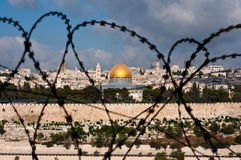 Jerusalem Through Razor Wire Stock Photo