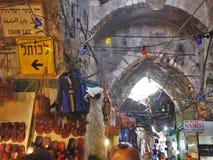 Jerusalem`s Bustling Muslim Quarter. Jerusalem, Israel - 02 June, 2017: Traditional Arabian arches in the hustle and bustle of Jerusalem`s Muslim quarter Royalty Free Stock Photo