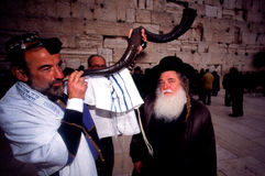 The Kotel - Israel. JERUSALEM - SEP 18: Jewish man blowing the Shofar at the Western Wall during Rosh Hashanah Jewish Holiday on September 18 2009 Royalty Free Stock Images