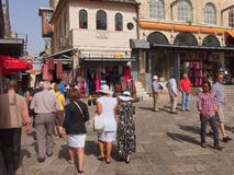 Walking in East Jerusalem Old Town. Tourists walking through the streets in Biblical East Jerusalem Old Town.A bucket list trip or visit to the Holy Lands stock photography