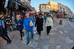 Jerusalem - 04.04.2017: Tourists walk trough the market in the o stock photos