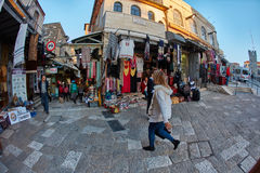 Jerusalem - 04.04.2017: Tourists walk trough the market in the o royalty free stock images