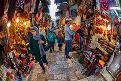 Jerusalem - 04.04.2017: Tourists walk trough the market in the o royalty free stock photography