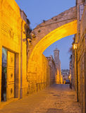Jerusalem - Via Dolororosa and the entry in the church of Flagellation at dusk. Royalty Free Stock Images