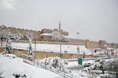 Jerusalem walls during snowfall stock photography