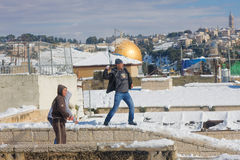 Jerusalem youth playing snowballs Stock Images