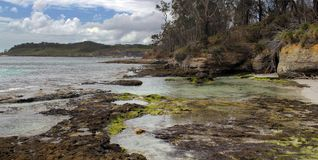 Jervis Bay. Australia. Jervis Bay sea side. Rocks, water and forest. Australia stock photo