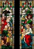 Jesús y ventana de cristal manchada de los niños Foto de archivo