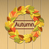 Jesieni ilustracja z liścia wiankiem na jaskrawym drewnianym tle Obrazy Royalty Free