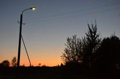 Jesieni słońce ustawia Fotografia Royalty Free