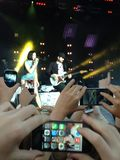 Jessie J at Bedgebury Concert. Hands and phones. 2 Royalty Free Stock Image