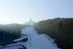 Jested Transmitter Tower with Ski Slope and Cable Car in Winter, Czech Republic, Europe. Jested  - Famous Transmitter Tower on a Mountain Top near Liberec with Royalty Free Stock Image