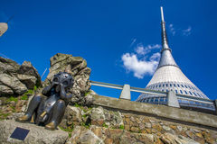 Jested lookout tower, Liberec, Czech Repiblic. Jested lookout tower with a scuplture from Jaroslav Rona - sad alien, Liberec, Czech Repiblic Royalty Free Stock Photos