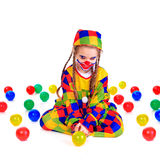 Jester. Young girl as jester on white background Stock Photo