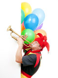 Jester blowing trumpet Royalty Free Stock Image
