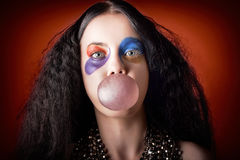Jester girl blowing bubblegum ball Stock Photos