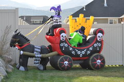 Jester and Halloween carriage Royalty Free Stock Photos