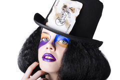 Jester with joker card on hat Royalty Free Stock Photo