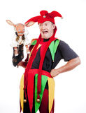 Jester with a puppet. Jester - entertaining figure in typical costume with puppet Royalty Free Stock Photos