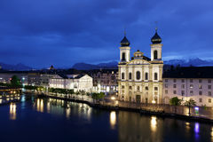 Jesuit church by the river Reuss by night Stock Photography