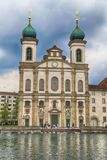 Jesuit Church on waterfront of Reuss River, Lucerne, Switzerlan. LUCERNE, SWITZERLAND - MAY 6, 2013: Jesuit Church on waterfront of Reuss River, Lucerne royalty free stock image