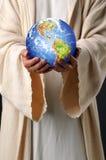 Jesus übergibt Holding-Erde Stockbilder