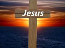 Jesus. A cross with the name of Jesus written on it with a sunset backround Royalty Free Stock Image