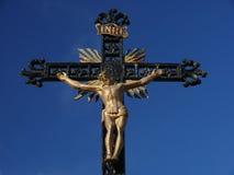 Jesus. On a cross on blue sky background stock image