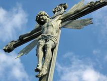Jesus. Cross with Jesus and blue sky Stock Photos