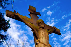 Jesus. Look on cross with Jesus and blue sky Stock Photography