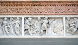 Jesus accompanies the journey of the disciples. By Zaccaria da Volterra, door of San Petronio Basilica in Bologna, Italy Royalty Free Stock Images