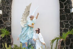 Jesus and Angel. Sculpture in the gadern of church, Hawaii Stock Photos