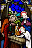 Jesus as a child working as a carpenter. Stained glass window with Jesus as a carpenter royalty free stock photos