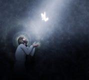 Jesus Baptism por el ejemplo de la lluvia de los cielos Fotografía de archivo
