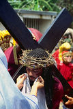 Jesus bearing his cross. Yearly performance (Moriones festival) during the holy week at easter of the sacrifices, death and resurrection of Jesus Christ on the Stock Images