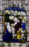 Jesus blessing a child in stained glass Royalty Free Stock Photography