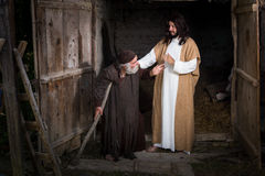Jesus blessing the lame. Jesus healing the lame or crippled man Stock Photo