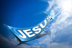 Jesus - Blue Arrow on Blue Sky with Clouds. 3D illustration of a Blue arrow with text Jesus against a blue sky with clouds and sun rays Royalty Free Stock Photography