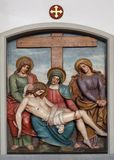 Jesus body is removed from the cross, 13th Stations of the Cross Royalty Free Stock Image