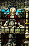 Jesus with bread and wine (The Last Supper). A stained glass photo of Jesus with bread and wine stock images