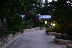 Jesus brotherhood monastery Latrun, chapel with cross and garden, Israel royalty free stock photos